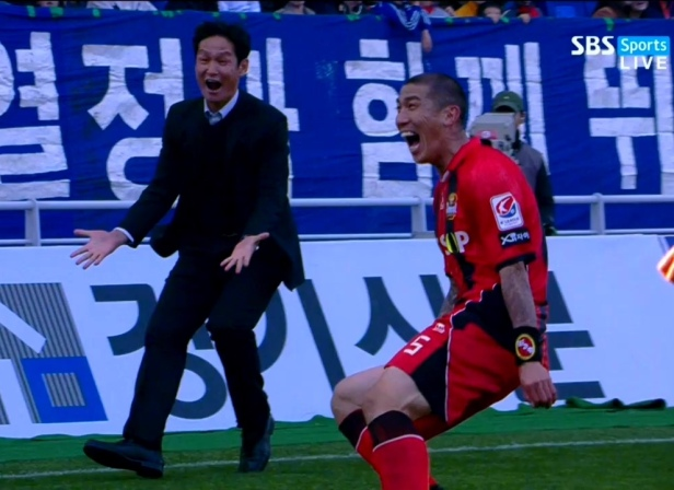 FC Seoul winger Cha Du Ri and manager Choi Yong-soo celebrate their sides 93rd minute Super Match winner.