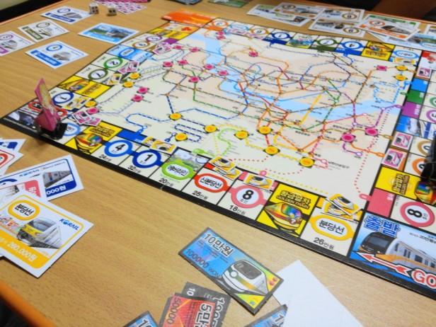 Korean Seoul Subway Monoploy Board Game in play
